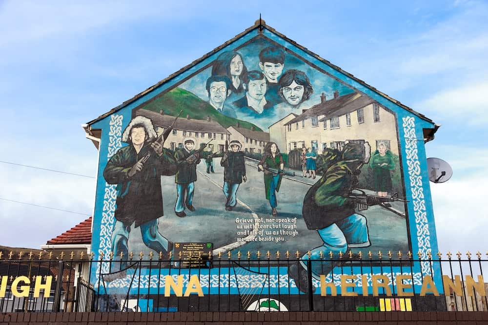 BELFAST NORTHERN IRELAND - Mural in Glenalina Road containing five portraits of the IRA members commemorated in Belfast Northern Ireland.