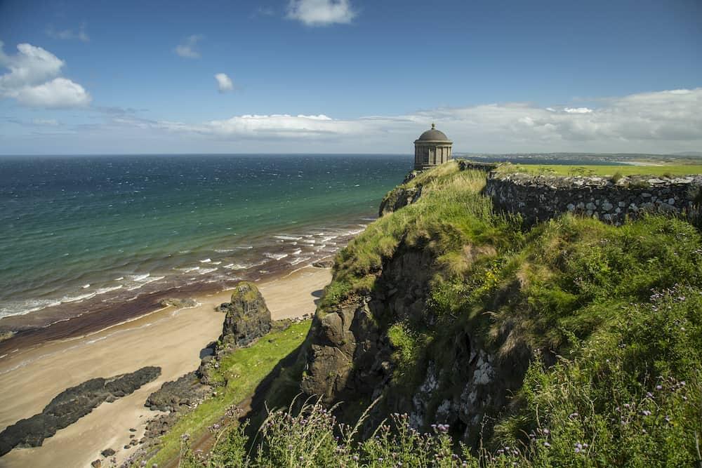 Northern Ireland - Mussenden Temple a popular tourist attraction on the Atlantic Ocean coast of Northern Ireland.