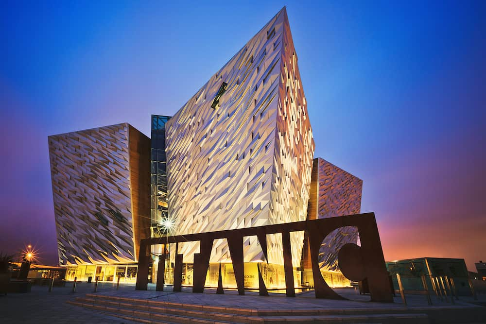 BELFAST, NORTHERN IRELAND - Sunset over Titanic Belfast - museum, touristic attraction and monument to Belfast's maritime heritage on the site of the former Harland and Wolff shipyard.