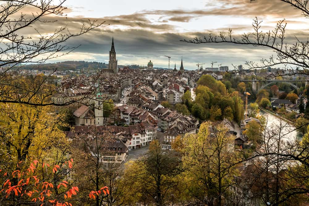 Panoramic view of the Bern old town with the Aare river flowing around the town at sunset in Bern, Switzerland