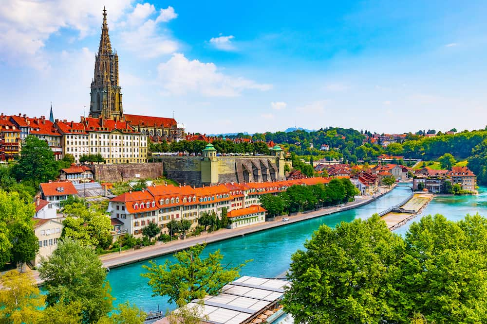 Scenic summer view of the Old Town architecture of Bern and Aare river embankment in Berne, Switzerland
