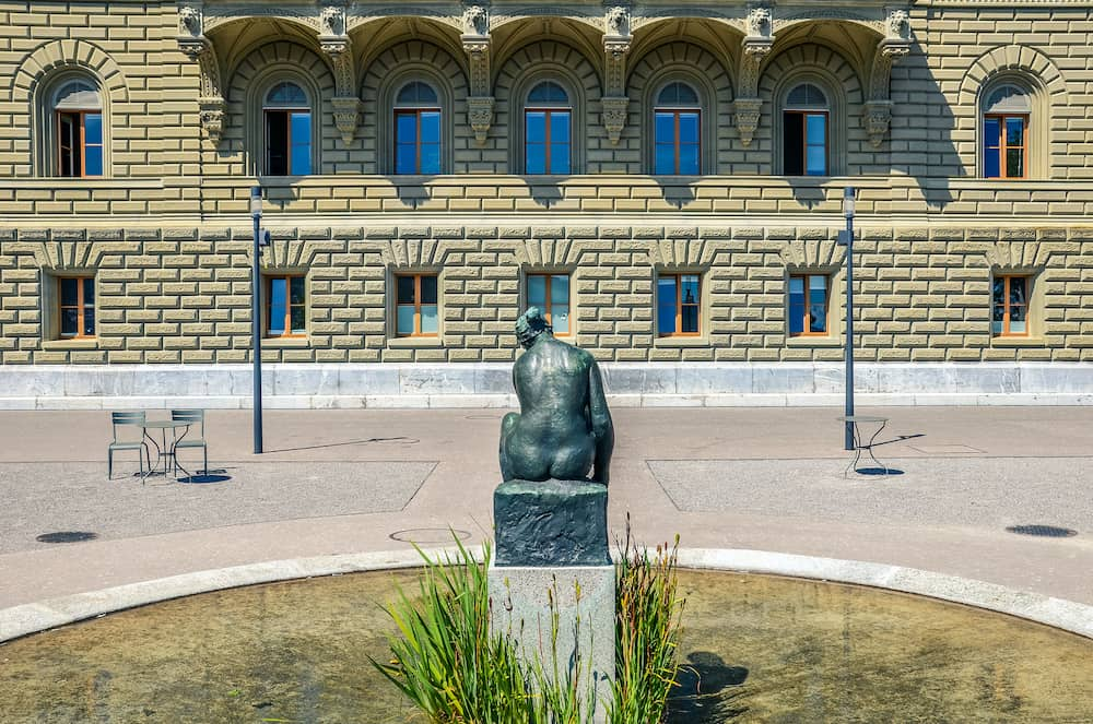 Bern, Switzerland - Sculpture of naked woman photographed from behind close to the Parliament Building in the Swiss capital. Women sculpture, woman statue. Classical, art, artwork