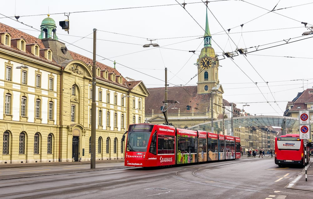 BERN SWITZERLAND - : Siemens Combino tram on Bubenbergplatz in Bern on February 15 2015. There are 36 trams of this class in Bern