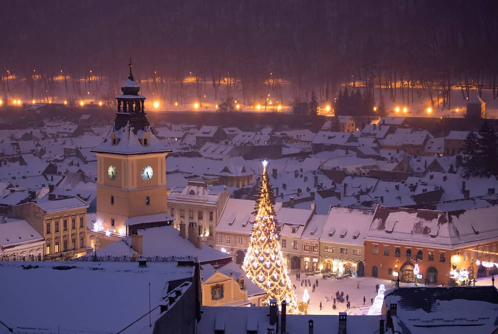 Aerial view of Brasov in the evening on a snowy winter day.