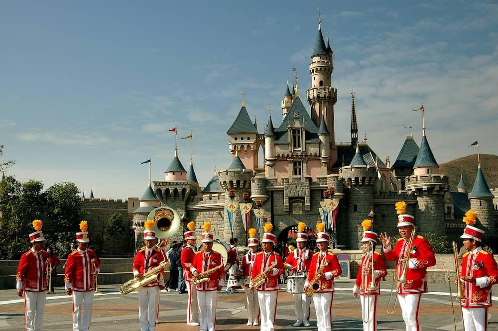 Hong Kong China - Hong Kong Disneyland marching band and the Sleeping Beauty Castle