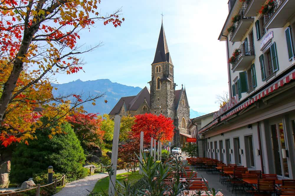 Interlaken, Switzerland - Hoeheweg Boulevard with hotels, restaurants, shops. Interlaken is a popular resort town lying between beautiful lakes in Interlaken, Switzerland