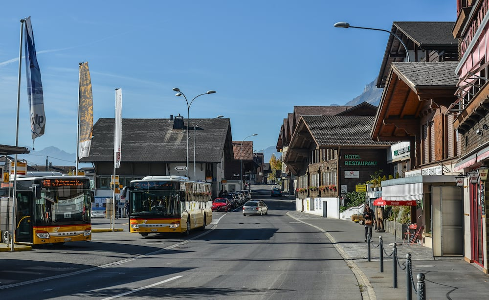 Brienz, Switzerland - Local buses at old town in Brienz, Switzerland. Brienz is a beautiful town on the lakeside, attracting many tourists.