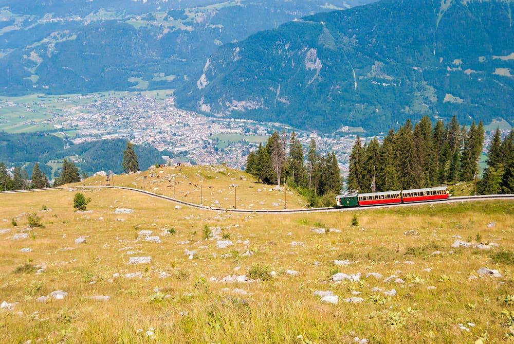 Retro passenger train moves from Schynige Platte to Interlaken. Switzerland