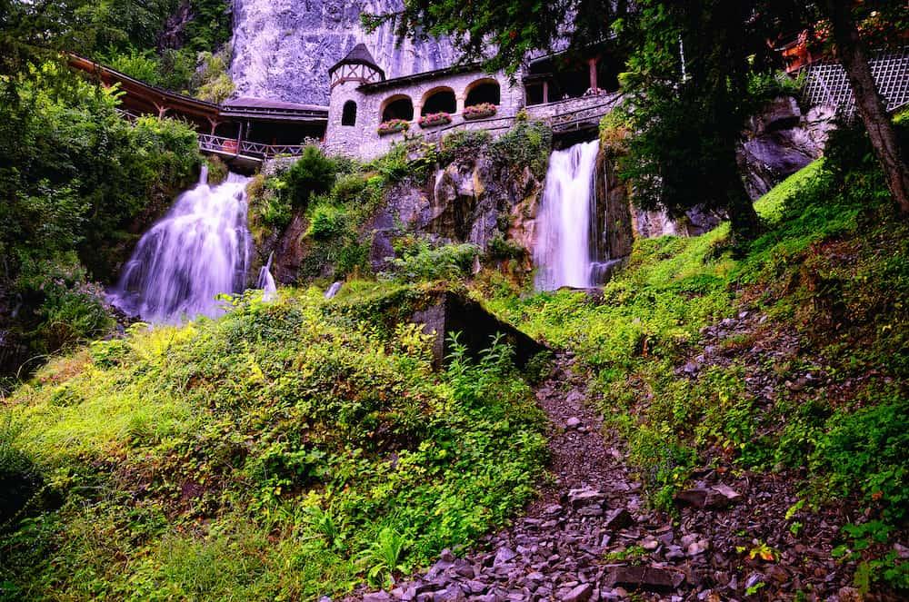 Waterfall at the Entrance to Saint Beatus Caves on Lake Thun in Beatenberg Municipality, Interlaken District, Canton of Bern, Switzerland