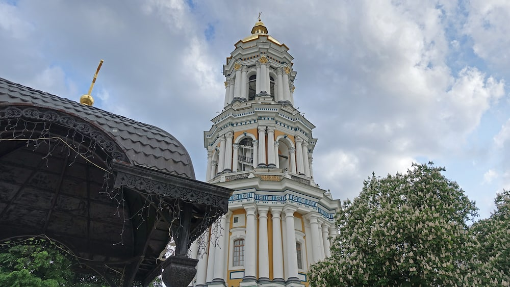 Great Lavra Bell Tower on a spring day in the Kiev Pechersk Lavra, blooming chestnuts