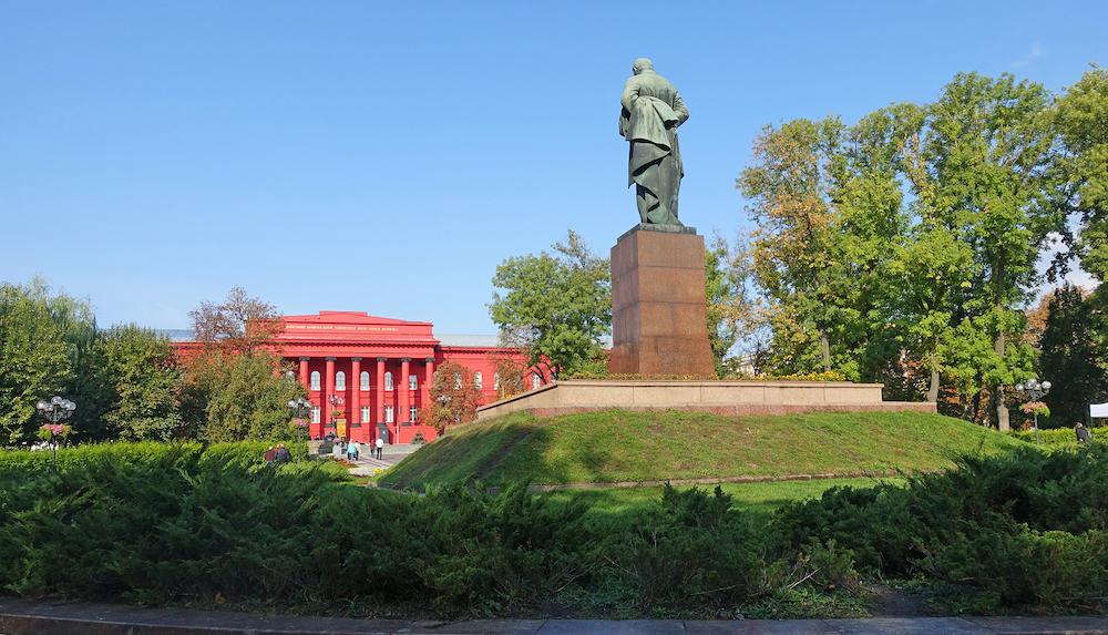 Kiev. Ukraine. Monument to the poet Taras Shevchenko on the background of Kiev University on an autumn day