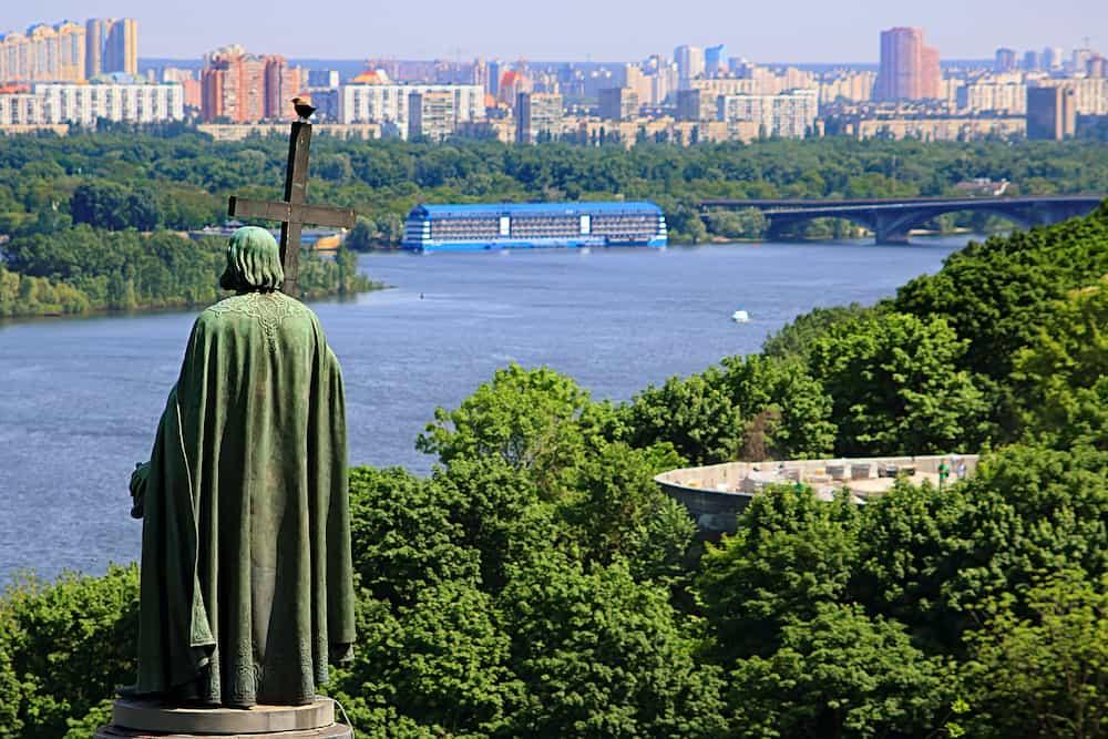 Saint Vladimir Monument in urban park Volodymyrska Hill and view of Dnieper River in Kyiv, Ukraine