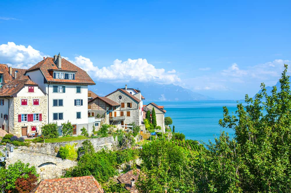 Amazing winemaking village Rivaz in the Swiss Lavaux wine region. Houses and vineyard located on the slopes by the stunning Lake Geneva. Natural landscapes in Switzerland. European travel destination