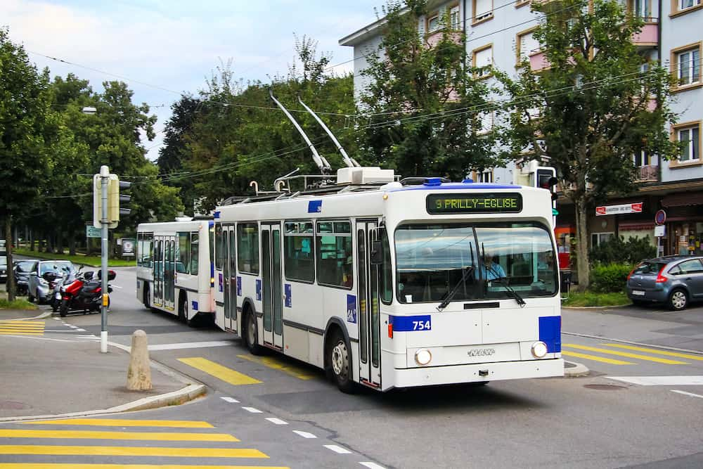 Lausanne, Switzerland - Old trolleybus NAW Lauber 91T with a trailer in the city street.