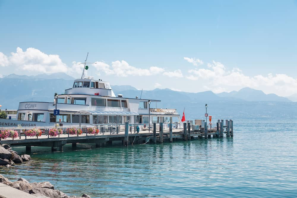 Lausanne, Switzerland - Passenger ship docked at pier in Lausanne Ouchy port, Switzerland on Lake Leman (Geneva Lake) on sunny summer day