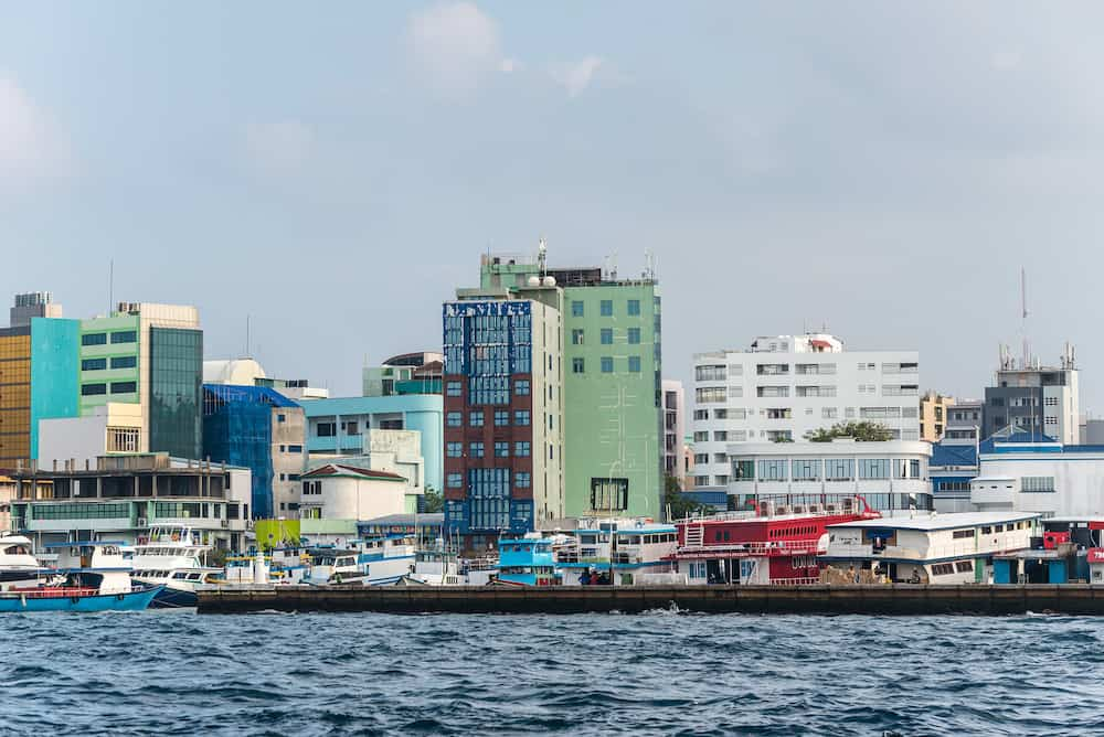 Male, Maldives - Waterfront cityscape of Male city as seen from the boat in Maldives, Indian Ocean.