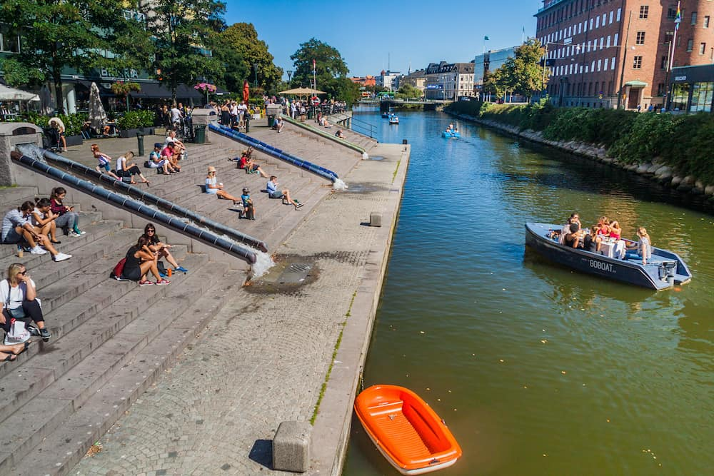 MALMO, SWEDEN - People enjoy a sunny day at Rorsjo canal in Malmo, Sweden.