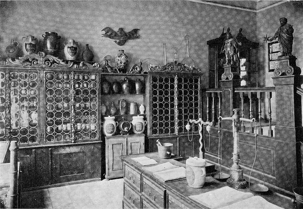 Supply room of an old pharmacy at the Germanic National Museum of Nuremberg, vintage engraved illustration. From the Universe and Humanity, 1910.