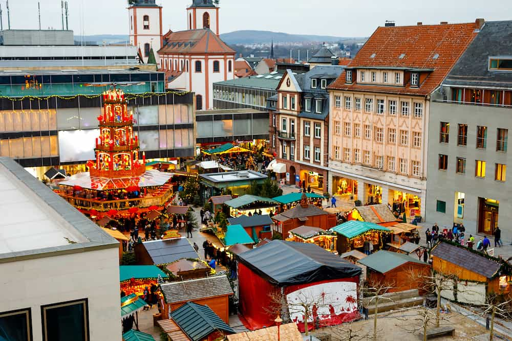 Traditional christmas market in the historic center of Nuremberg, Germany. Decorated with garland and lights sale stalls with sweets, mulled wine and Xmas decoration and German gifts.
