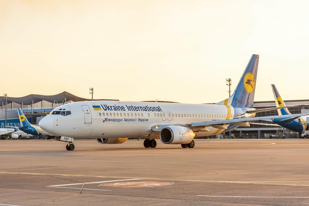 KYIV, UKRAINE - Aircraft of Ukraine International Airlines near airport terminal