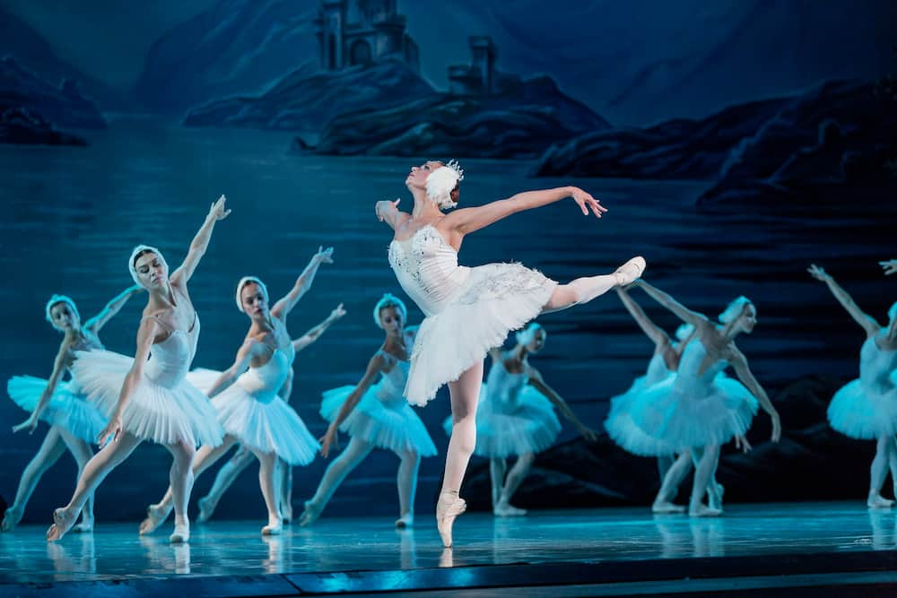 ODESSA, UKRAINE : ballet. Classical ballet on stage of Odessa Opera Theater. Ballet dancers on stage dance classical works of Swan Lake. Form of artistic ball dance on stage of theater