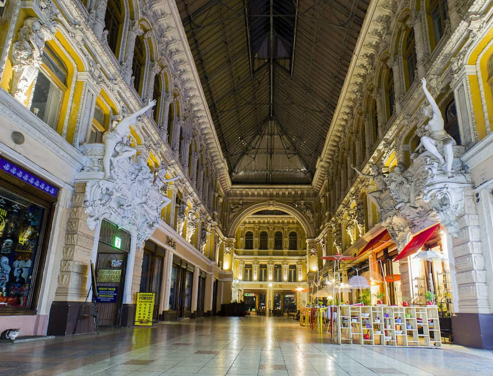 """ODESSA / UKRAINE - : Night panorama on shops and cafe in """"Passage"""" indoor shopping mall on Derybasivska Street in Odessa dates which from the late 19th Century."""
