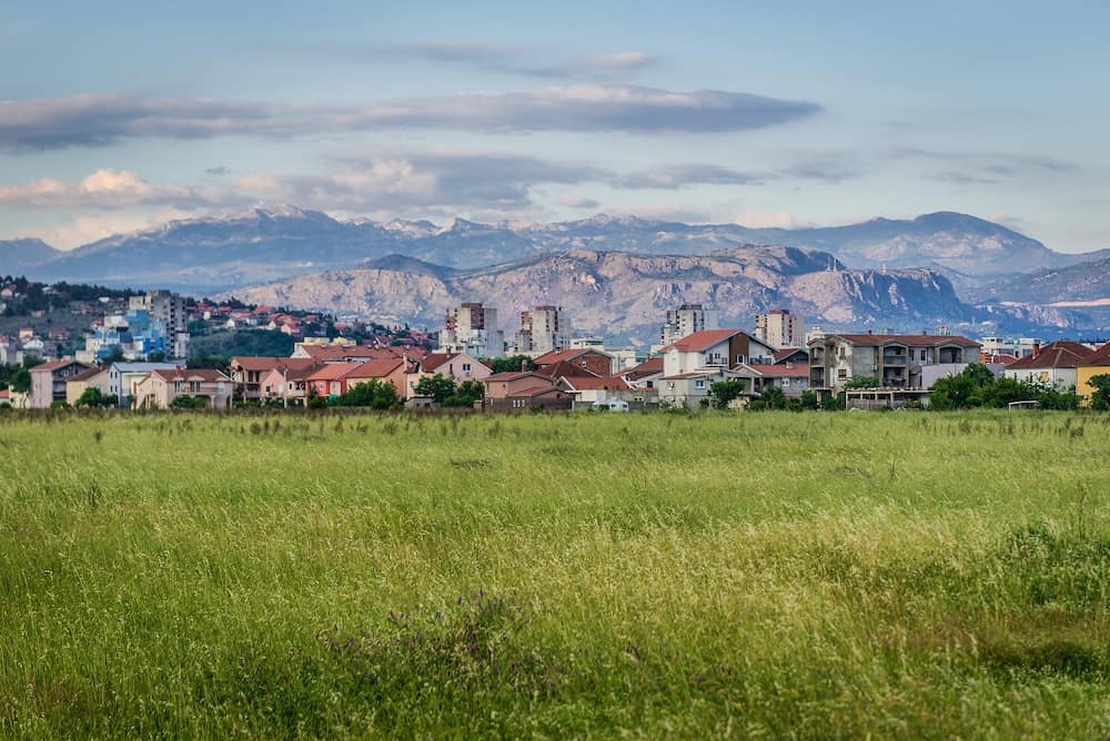 Meadow and buildings in Podgorica city in Montenegro