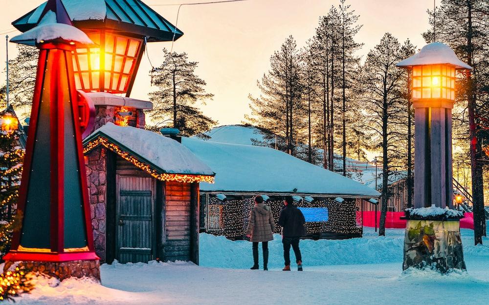 Couple in Santa Claus Village in Rovaniemi new