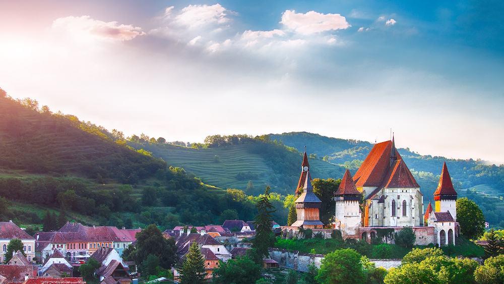 Beautiful medieval architecture of Biertan fortified Saxon church in Romania protected by Unesco World Heritage Site. Amazing sunset in Biertan.Transylvania, Sibiu, Biertan, Romania, Europe.
