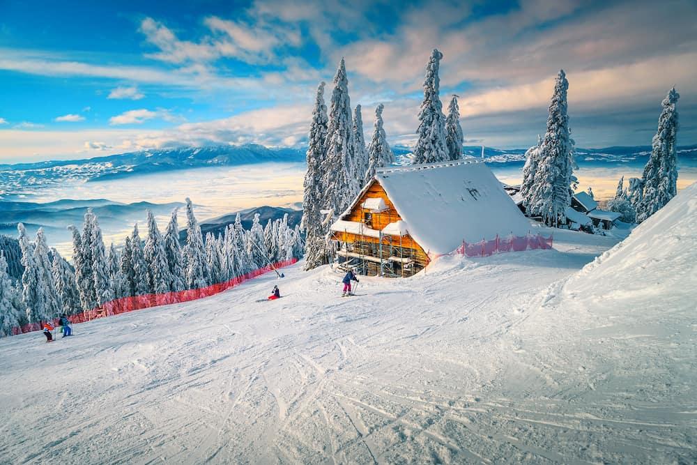 The best popular winter ski resort with skiers in Romania. Amazing touristic and winter holiday destination. Winter sunny day in Poiana Brasov ski resort, Transylvania, Romania, Europe