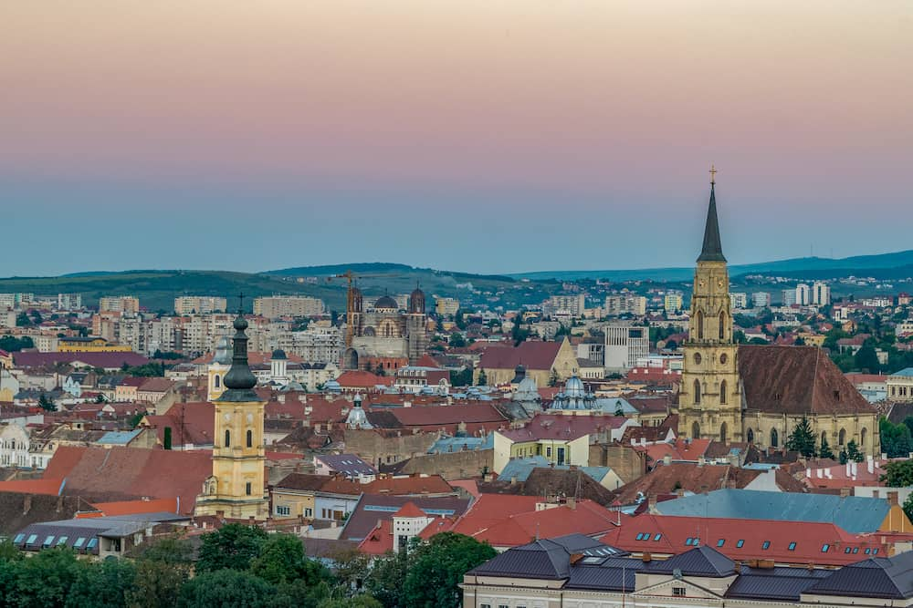 The old city of Cluj-Napoca at sunset viewed from Cetatuia Park in Cluj-Napoca, Romania