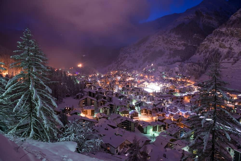 aerial view on zermatt valley and matterhorn peak at dusk with fresh snow in switzerland