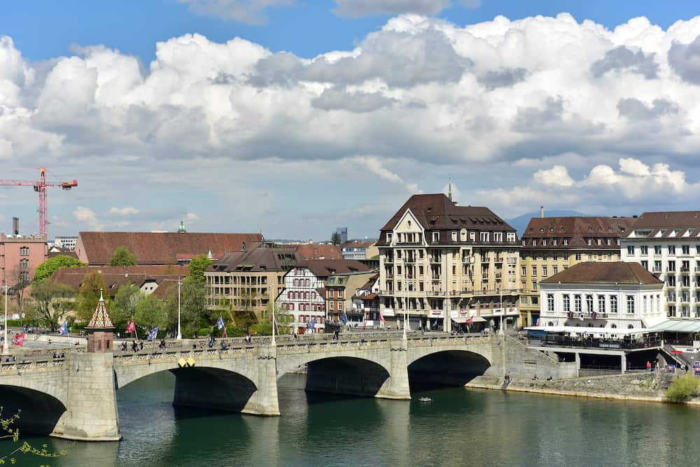 BASEL, SWITZERLAND - . Rhine river on a spring sunny day. View of the Middle Bridge. City of Basel, Switzerland, Europe.
