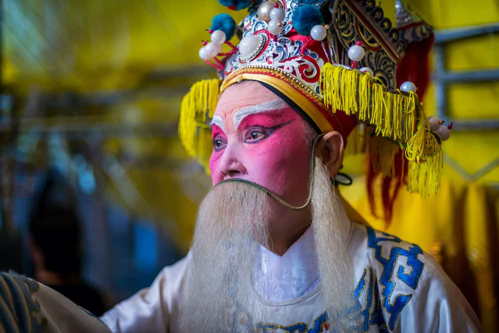 South East Asia / Singapore - Chinese Teochew Opera. Performers at backstage getting ready to perform during Chinese Ghost Festival. Asian traditional cultural arts.