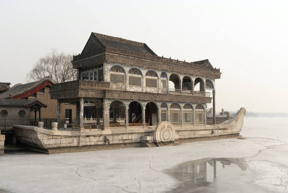 Summer palace marble boat during winter on ice lake in Beijing, China