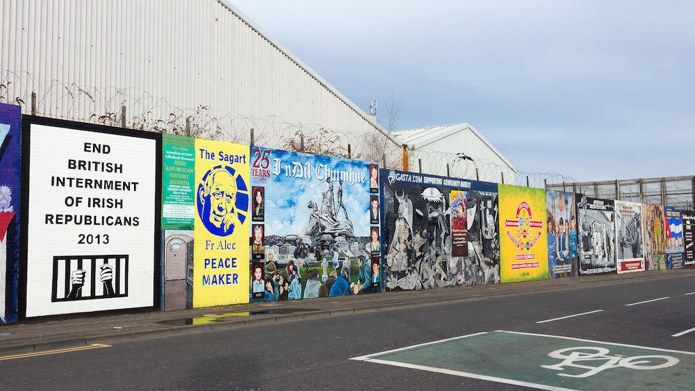 BELFAST NORTHERN IRELAND -Political mural in Belfast Northern Ireland. Falls Road is famous for its political murals.