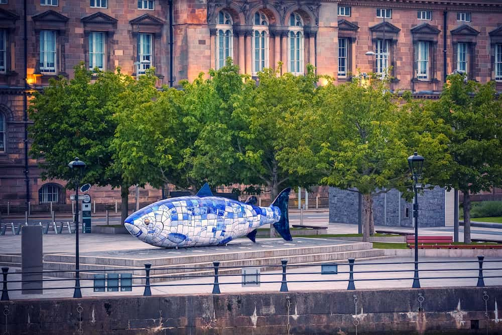 BELFAST, NORTHERN IRELAND - The Big Fish is a printed ceramic mosaic sculpture in Belfast also known as The Salmon of Knowledge. The work celebrates the regeneration of the Lagan River.