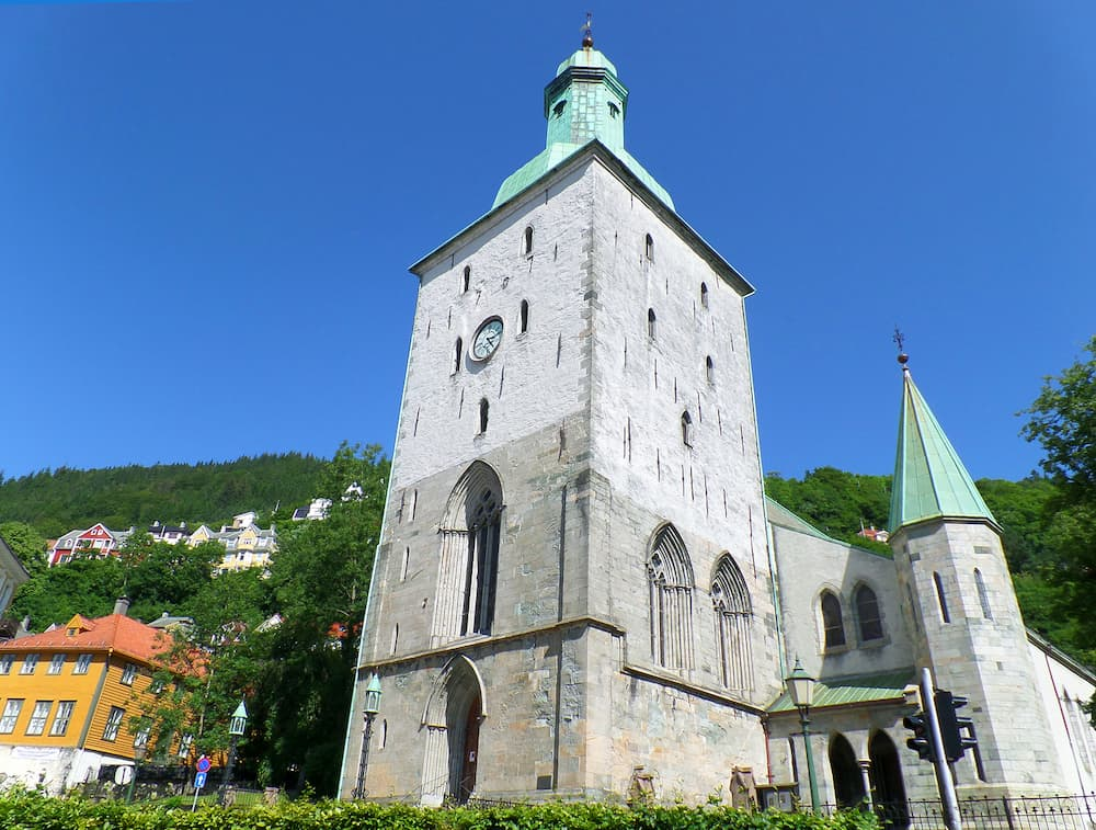 Bergen Cathedral, stunning medieval stone church against the vivid blue clear sky, Bergen, Norway