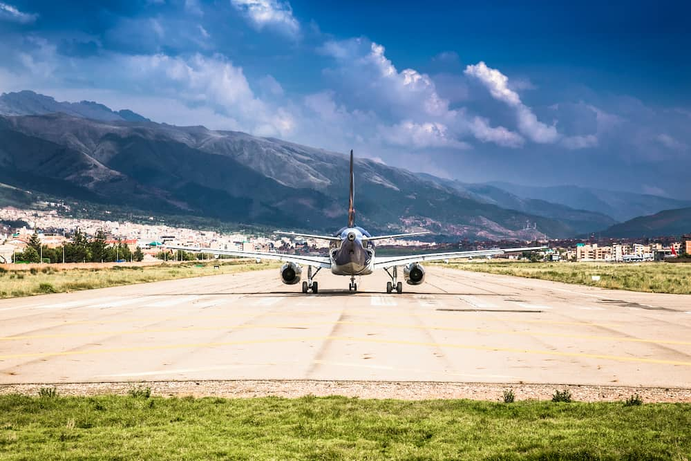Modern passenger plane at airport lane moving to take off , Cusco , Peru. South Amerca.
