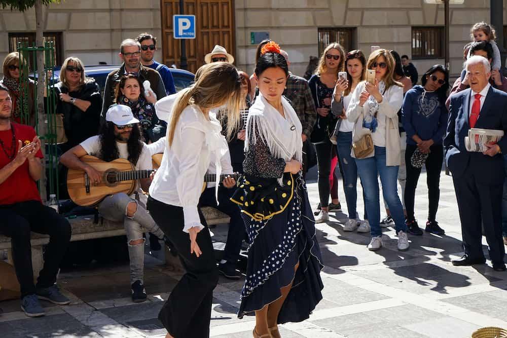 GRANADA, SPAIN : Japanese flamenco dancer dancing for tourists in Plaza Nueva, Low Albaicin.