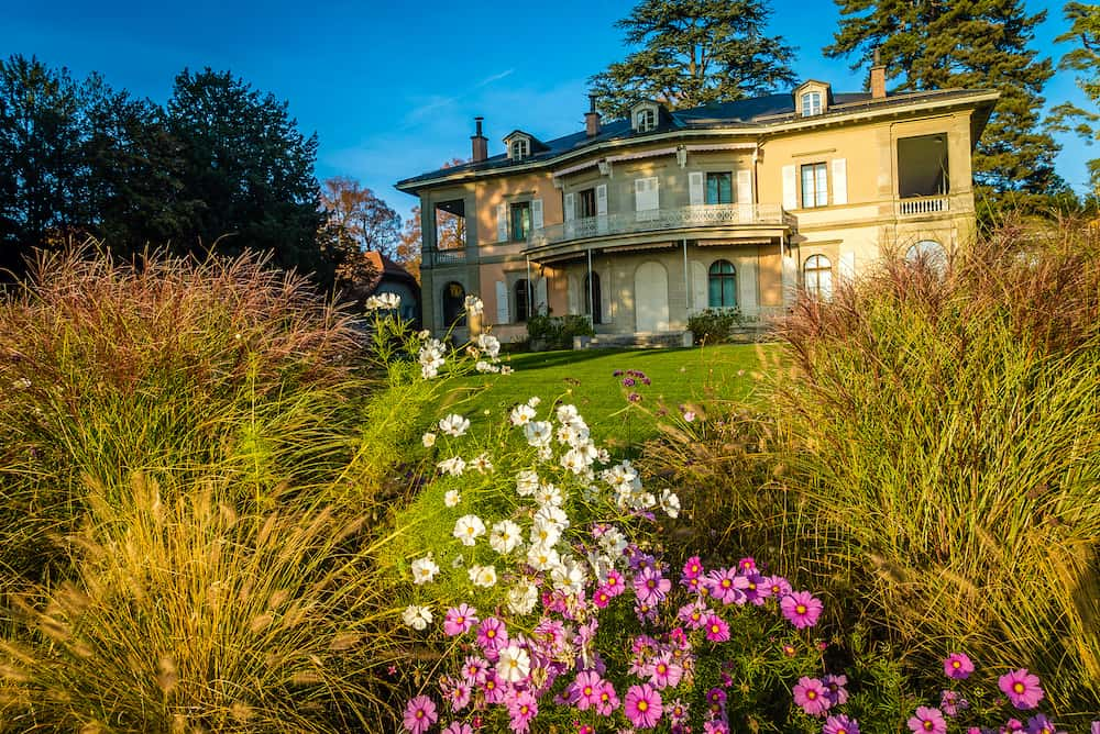 Fondation de Hermitage in Lausanne with flowers at sunset
