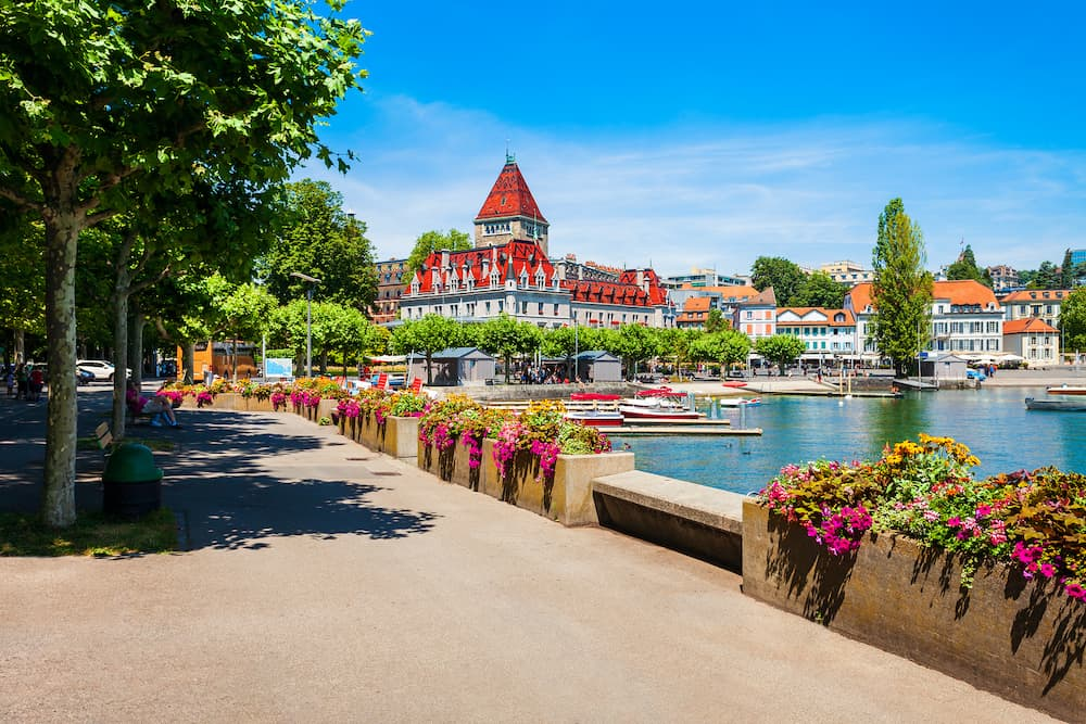 Geneva lake promenade near the Chateau Ouchy Castle, an old medieval castle in Lausanne city in Switzerland