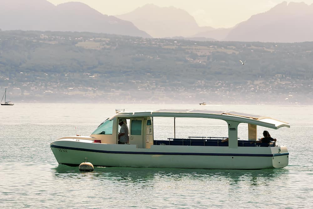 Lausanne Switzerland - Motor boat with people on board on Lake Geneva in Lausanne Switzerland