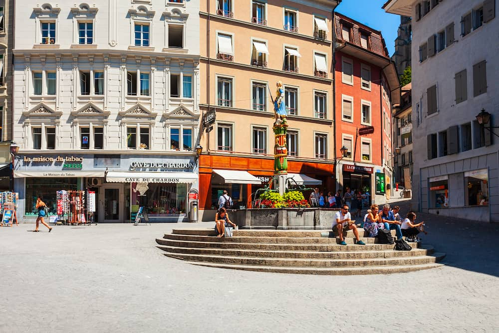 LAUSANNE, SWITZERLAND - Place de la Palud square with fountain is the oldest square in Lausanne city, which located on Lake Geneva shores in Switzerland
