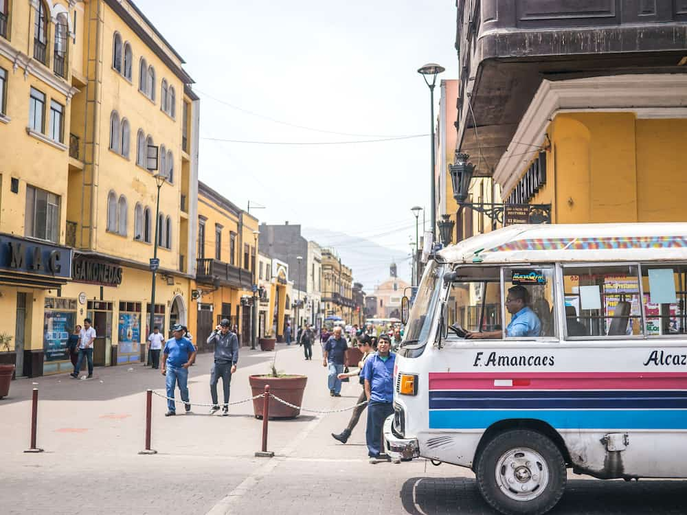 Lima, Peru - A typical Lima bus crossing in front of Jiron Trujillo street in downtown Lima Peru.