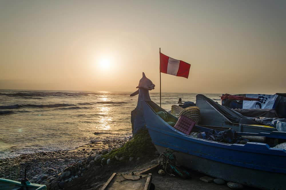 Boat with the flag of Peru on the beach Pescadores in Chorrillos, Lima - Peru