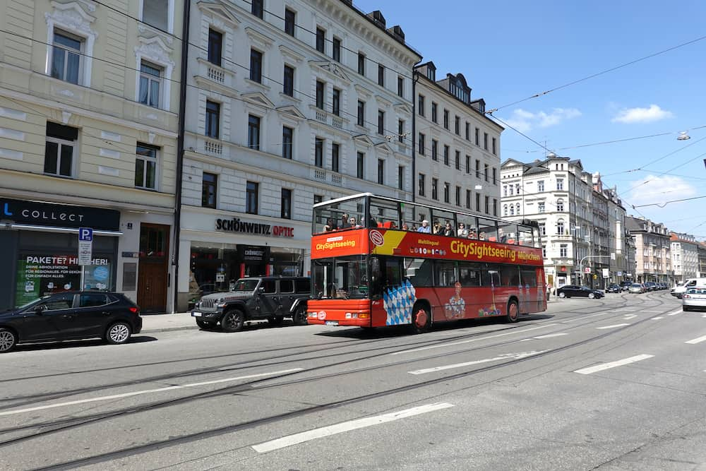 Munich. Bavaria / Germany - Excursion bus with foreign tourists moves on Munich street on sunny day