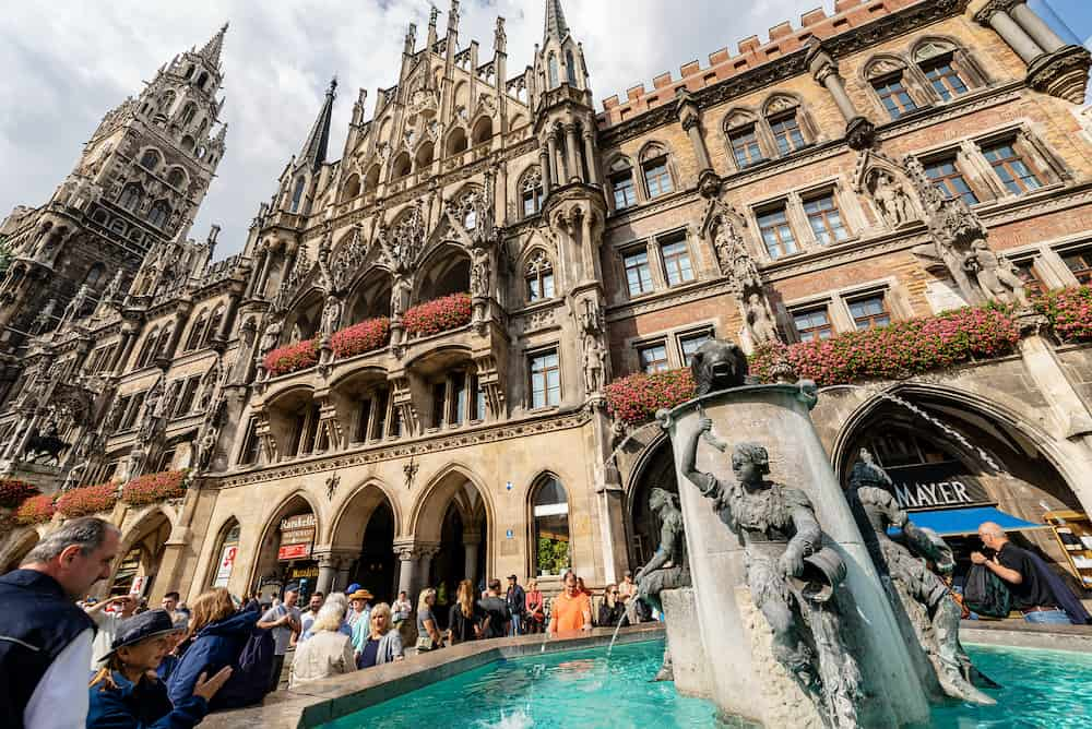 MUNICH, GERMANY - Fischbrunnen (Fish Fountain) and the Neue Rathaus of Munich (New Town Hall) in Marienplatz, the town square in historic center. Germany, Europe