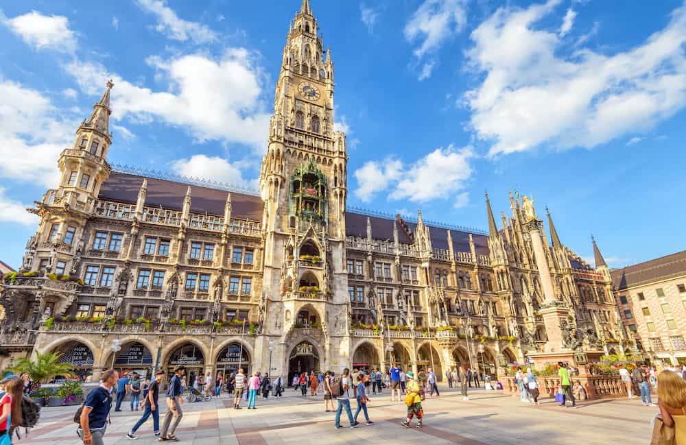 Munich, Germany - People visit Marienplatz square in Munich. Panorama of Town Hall or Rathaus in summer. It is a famous Gothic landmark of Munich. Concept of travel in Munich city.
