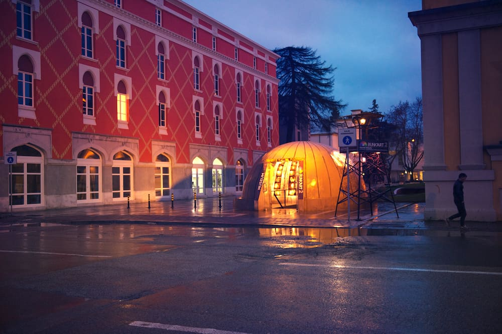 Tirana, Albania.City center sightseeing tourist attraction Bunk Art previously nuclear bunker during communism regime, rainy evening illuminated reflections